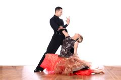Latino dancers in ballroom against white background. The Latino dancers in ballroom against white background Royalty Free Stock Image