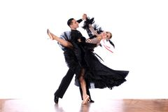 Latino dancers in ballroom against white background. The Latino dancers in ballroom against white background Stock Photo