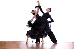 Latino dancers in ballroom. Against white background Royalty Free Stock Photo