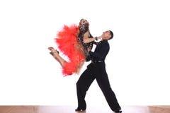 Latino dancers in ballroom Royalty Free Stock Photos
