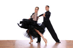 Latino dancers in ballroom Royalty Free Stock Image