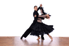 Latino dancers in ballroom against white background Stock Photography