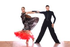 Latino dancers in ballroom against white background. The Latino dancers in ballroom against white background Stock Image