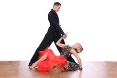 Latino dancers in ballroom against white background. The Latino dancers in ballroom against white background Stock Photos