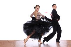 Latino dancers in ballroom against white background. The Latino dancers in ballroom against white background Stock Photography