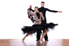 Latino dancers in ballroom against white background. The Latino dancers in ballroom against white background Stock Photo