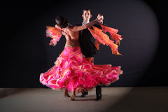 Latino dancers in ballroom  on black background Royalty Free Stock Image