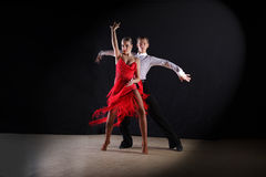 Latino dancers in ballroom isolated on black Stock Image