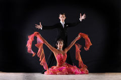 Latino dancers in ballroom Royalty Free Stock Image