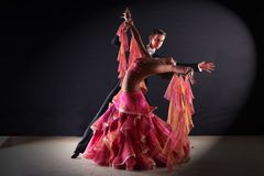 Latino dancers in ballroom. Isolated on black background Royalty Free Stock Photos