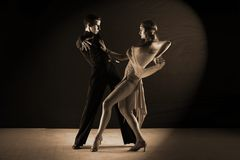 Latino dancers in ballroom isolated on black. Background Stock Image