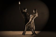 Latino dancers in ballroom isolated on black Stock Photos