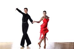 Latino dancers in ballroom. Isolated on white Stock Photography