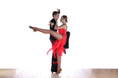 Latino dancers in ballroom Royalty Free Stock Photography