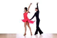 Latino dancers in ballroom Stock Image