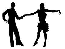 Latino dancing. A couple in costumes dancing Latin dances Stock Image