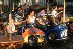 Latino family in bumper cars Stock Photos