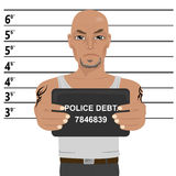 Latino gangster with tattoos holding mugshot Royalty Free Stock Photo