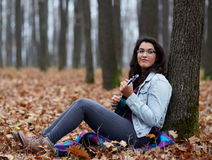 Latino girl playing ukulele Royalty Free Stock Photos