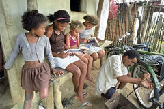 Latino girls are reading storybooks, Brazil. Brazil, Bahia, village Conde: in the Brazilian countryside is greeat illiteracy. In Conde people have therefore Royalty Free Stock Photo