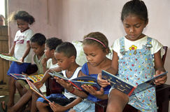 Latino kids reading picture books of Miffy, Brazil. Brazil, Bahia, village Conde: in the Brazilian countryside is greeat illiteracy. In Conde people have Stock Photo