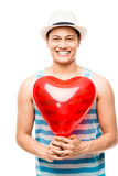 Latino lover with heart love balloon. Happy Latino lover man celebrating valentines day holding red heart love balloon Royalty Free Stock Image
