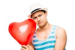 Latino lover with heart love balloon Stock Photo