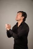 Latino male praying Royalty Free Stock Images