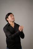 Latino male praying Stock Photos