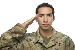 Latino Male soldier in camouflage salutes Stock Photography