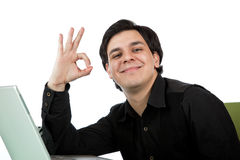 Latino man giving a okay hand gesture Royalty Free Stock Photos