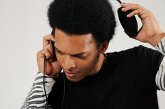 Latino man with headphones. Portrait of young trendy latino man with headphones Stock Photography