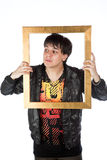 Latino man holding a gold picture frame Royalty Free Stock Photography