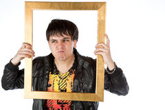 Latino man holding a gold picture frame Royalty Free Stock Photo