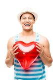 Latino man holding red heart balloon Royalty Free Stock Image