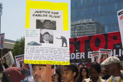 Latino man holding sign for justice Stock Photos