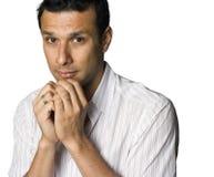 Latino man looking timid royalty free stock image