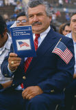 Latino man reading U.S. citizenship book. Latino American man with U.S. citizenship book at induction ceremony in East Los Angeles, CA Royalty Free Stock Photo