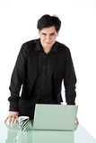 Latino man standing and working at a laptop Royalty Free Stock Photos