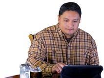 Latino Man Using Wireless Device Royalty Free Stock Photo