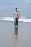 Latino man walking on a beach Stock Photo