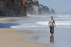 Latino man walking on a beach Royalty Free Stock Photography