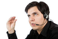 Latino man working as a call service rep Royalty Free Stock Photos