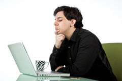 Latino man working at a laptop computer Stock Photo