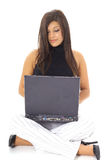 Latino model using computer Stock Photo