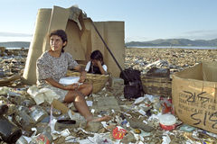 Latino mother and daughter work on garbage dump Royalty Free Stock Photos