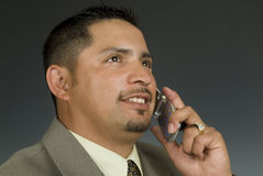 Latino phone. Well dressed hispanic male on cell phone royalty free stock images