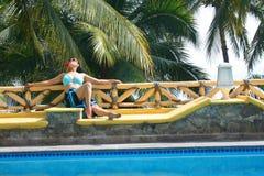 Latino portrait. Young latino woman next to pool Stock Photos