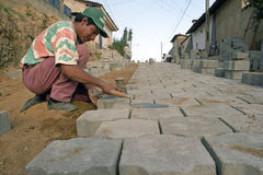Latino road paver working in a street, Nicaragua. Nicaragua, department of Nueva Segovia, Ocotal city: street scene with working latino, Nicaraguan, pavers. An Royalty Free Stock Images