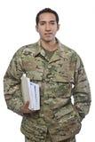 Latino-Soldat mit Schule-Büchern Lizenzfreie Stockfotos